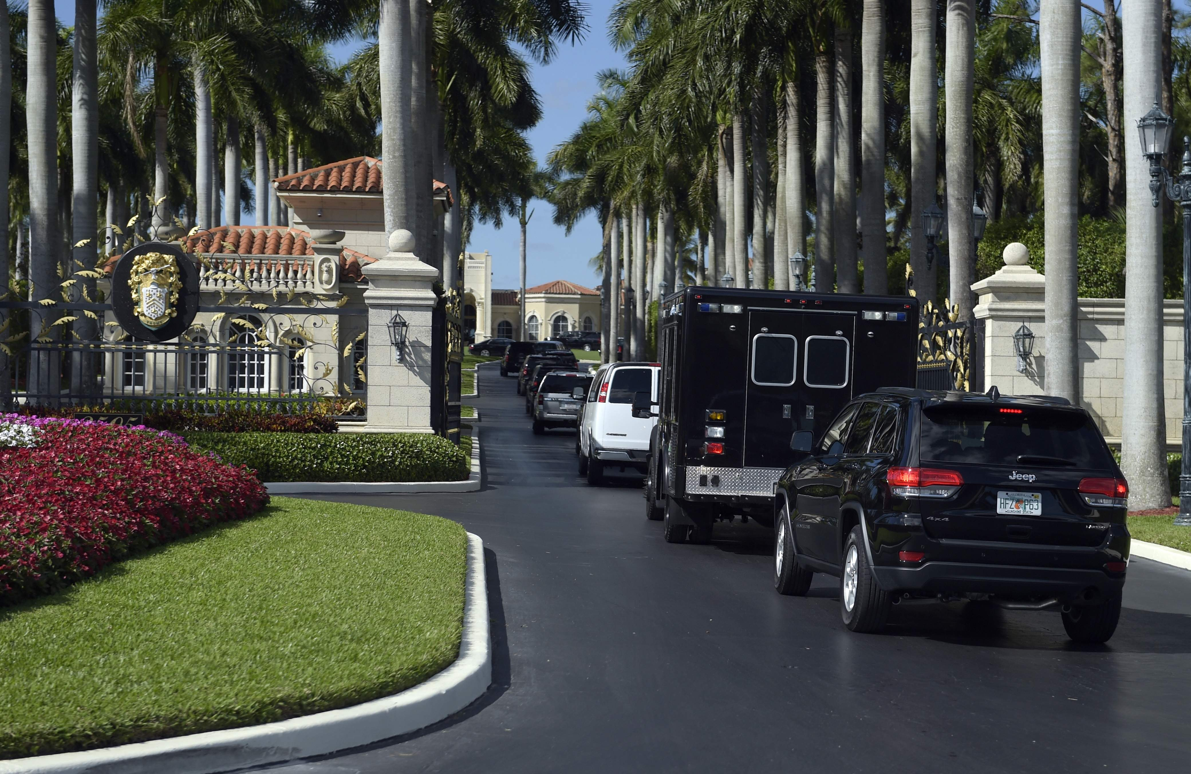 DAY 23 - In this Feb. 11, 2017, file photo, the motorcade with President Donald Trump and Japanese Prime Minister Shinzo Abe, arrives at Trump International Golf Club in West Palm Beach, Fla. The president was in Mar-a-Lago for the weekend and had no public events on his schedule for day 23 and was not photographed. (AP Photo/Susan Walsh, File)