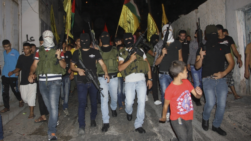 Masked Palestinian militants of Al-Aqsa Martyrs Brigades, march during a demonstration against the Israeli military action in Gaza, in Balata refugee camp in the West Bank city of Nablus, Saturday, July 26, 2014. Hamas said it fired five rockets at Israel late Saturday after rejecting Israel's offer to extend a 12-hour humanitarian cease-fire by four hours, casting new doubt on international efforts to broker an end to 19 days of fighting. (AP Photo/Nasser Ishtayeh)
