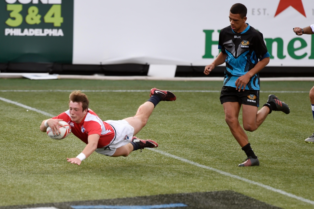 During a match between national development teams, a player from England scores a try against New Zealand during their match at the USA Sevens rugby tournament Saturday, March 4, 2017, at Sam Boyd Stadium. [Sam Morris/Las Vegas News Bureau]