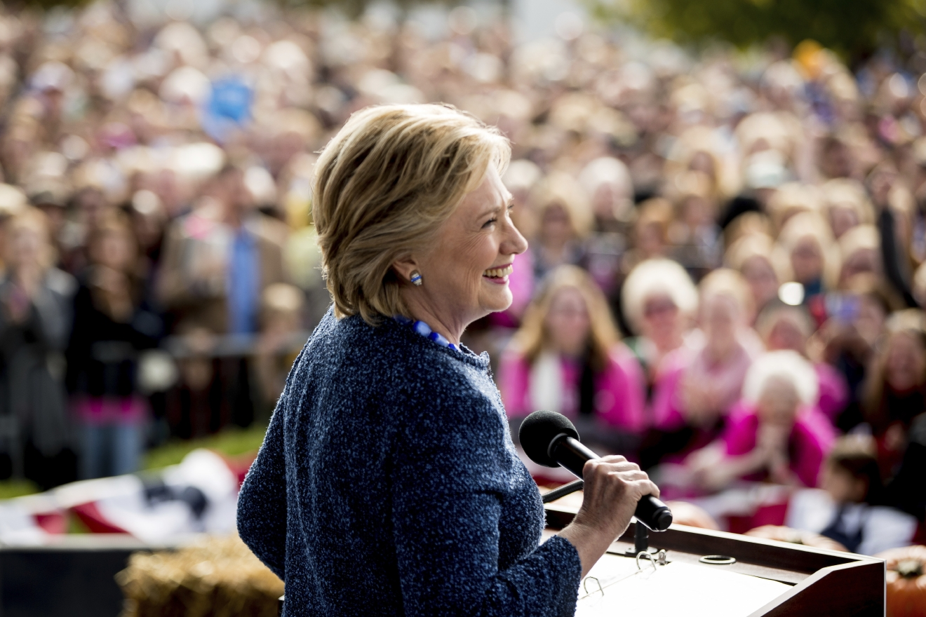 Democratic presidential candidate Hillary Clinton pauses while speaking at a campaign rally at NewBo City Market in Cedar Rapids, Iowa, Friday, Oct. 28, 2016. (AP Photo/Andrew Harnik)