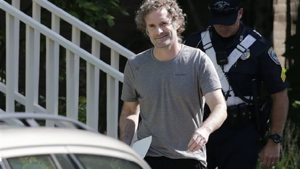 Peter Theo Curtis smiles as he walks towards reporters to read a statement outside his mother's home in Cambridge, Mass., Wednesday, Aug. 27, 2014. Curtis, a freelance reporter who wrote under the byline Theo Padnos and who had been held hostage for about two years in Syria, returned to the U.S. Tuesday. (AP Photo/Charles Krupa)