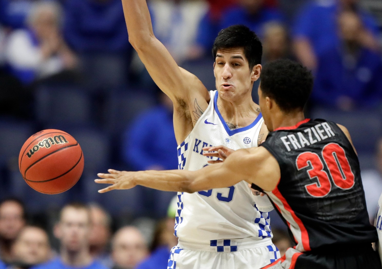 Georgia guard J.J. Frazier (30) passes past Kentucky forward Derek Willis during the first half of an NCAA college basketball game at the Southeastern Conference tournament Friday, March 10, 2017, in Nashville, Tenn. (AP Photo/Wade Payne)
