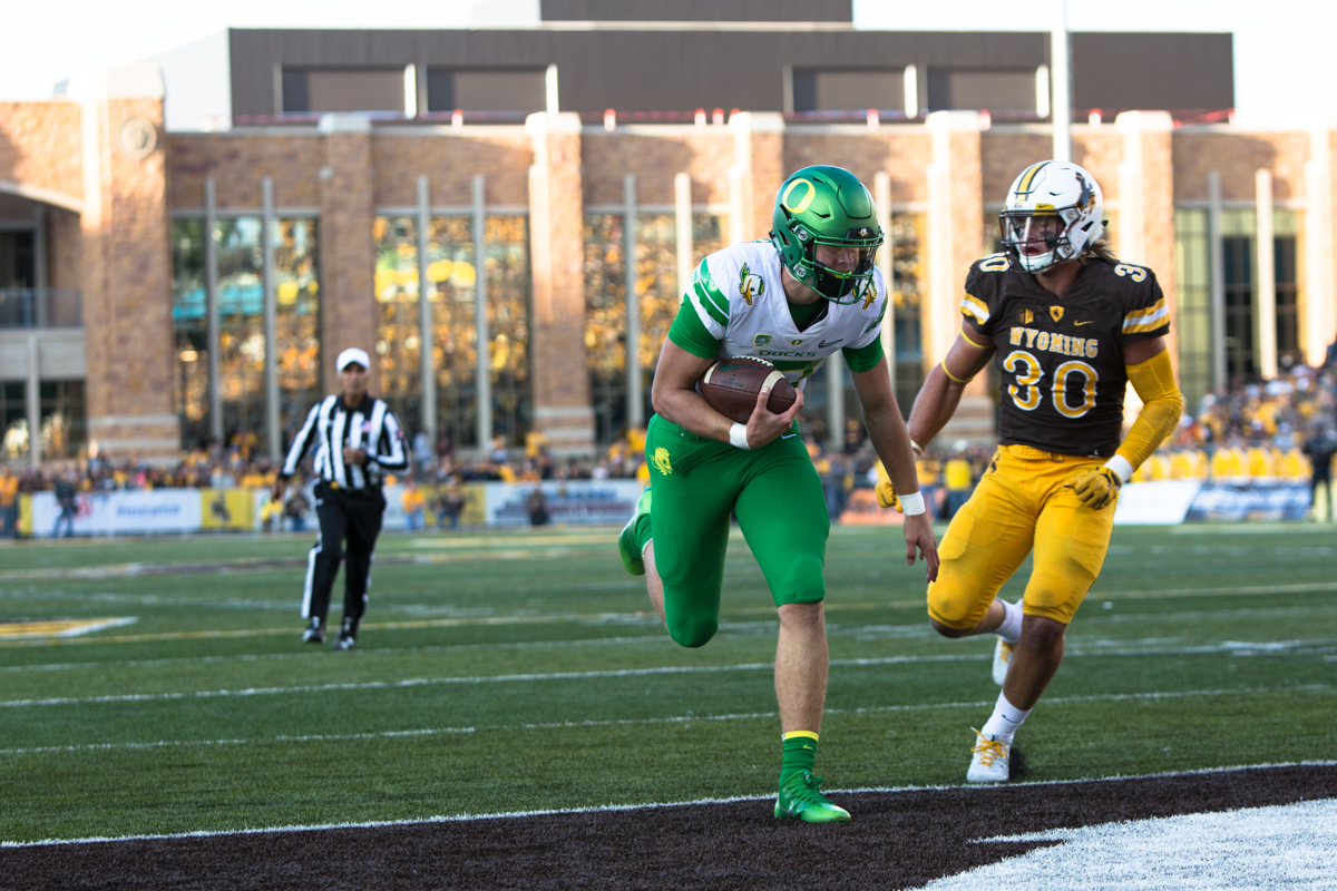 Oregon quarterback Justin Herbert (#10) carries the ball into the endzone for a touchdown. The Oregon Ducks lead the Wyoming Cowboys 42 to 10 at the end of the first half on Saturday, September 16, 2017 in Laramie, Wyo. Photo by Austin Hicks, Oregon News Lab
