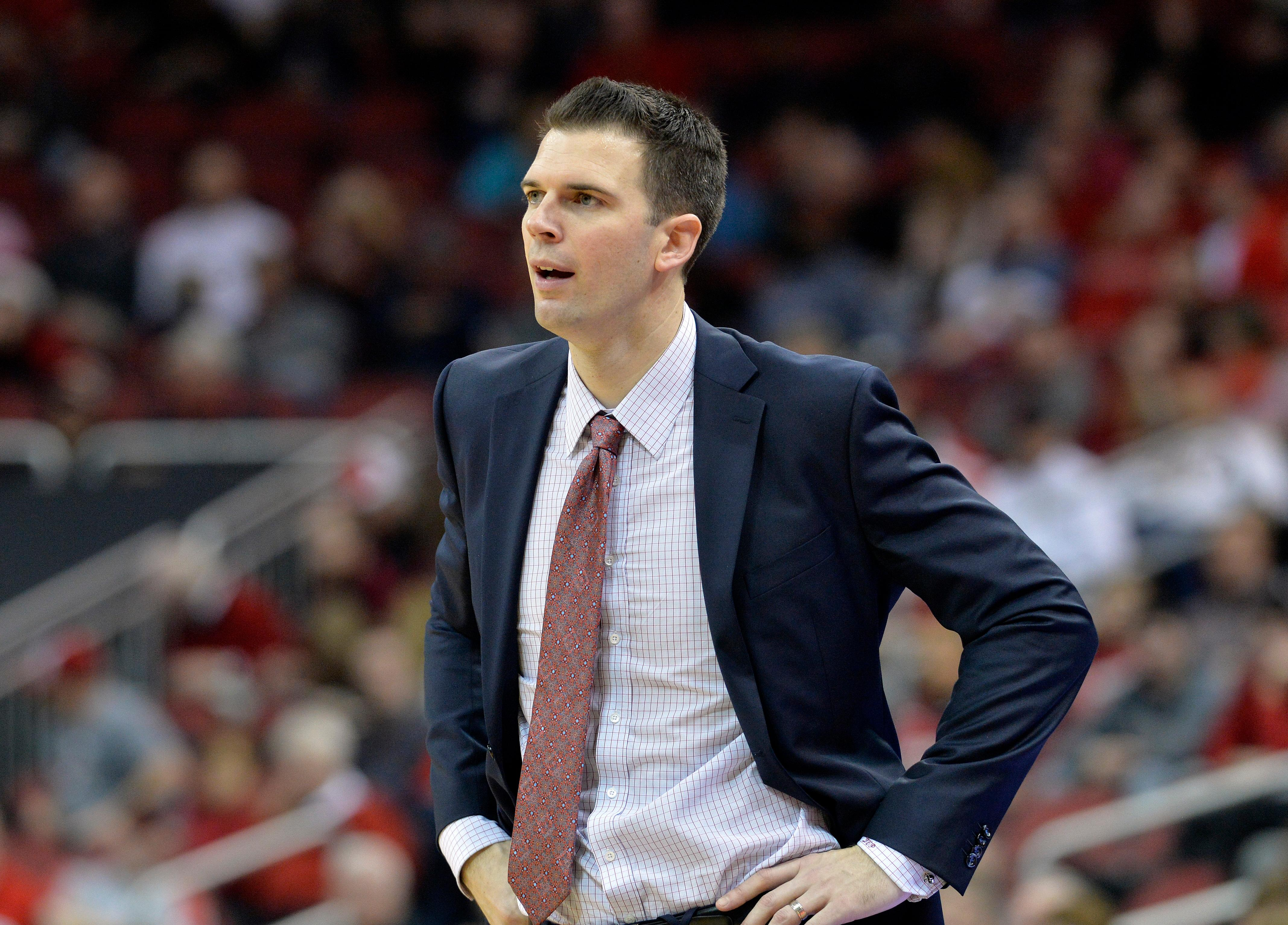 "File- This Dec. 23, 2017, file photo shows Louisville interim head coach David Padgett watching his team during the second half of an NCAA college basketball game in Louisville, Ky.  Padgett said he sees ""progress"" as his Cardinals have won six straight games entering Friday's trip to No. 16 Kentucky. (AP Photo/Timothy D. Easley, File)"