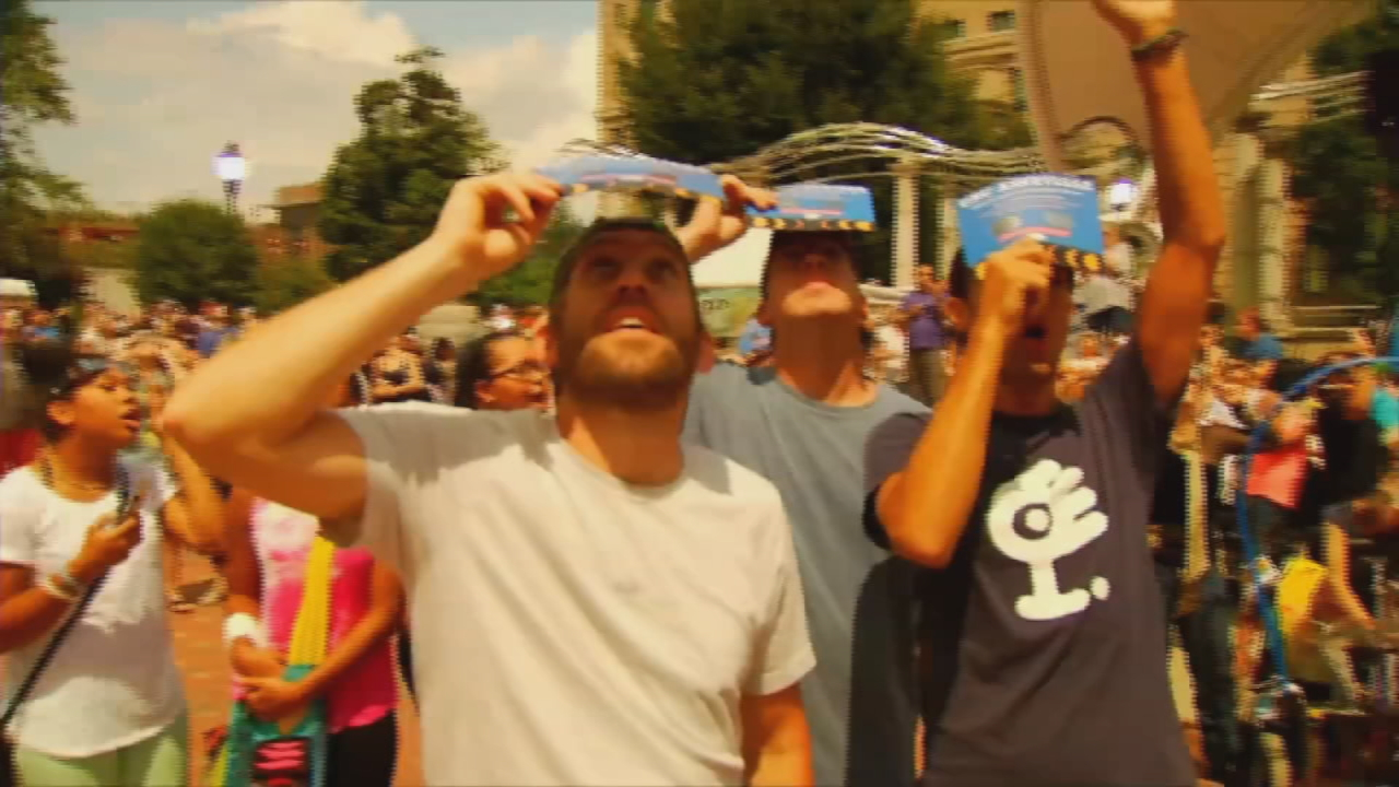 Scientists, tourists and locals gathered at Pack Square Park in downtown Asheville on Monday to watch the eclipse. (Photo credit: WLOS staff)