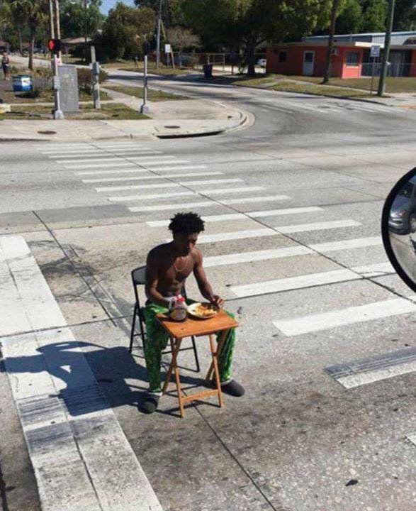 Authorities say they've charged a Florida man recorded on video sitting in the street eating pancakes. (Lakeland Police Department)