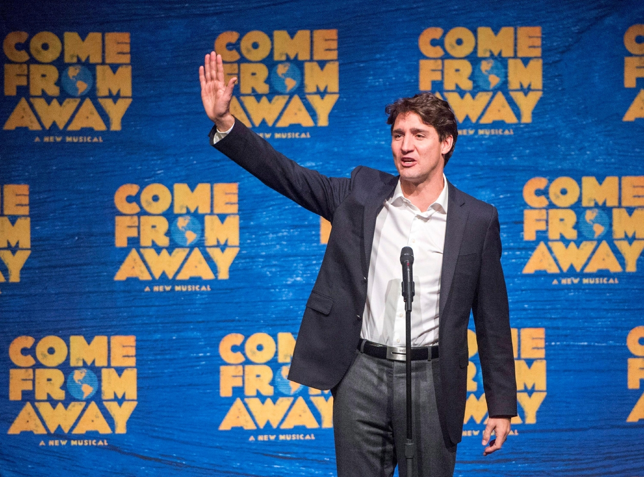 "Canadian Prime Minister Justin Trudeau speaks to the audience before the start of the Broadway musical ""Come From Away,"" in New York, on Wednesday, March 15, 2017. (Ryan Remiorz/The Canadian Press via AP)"