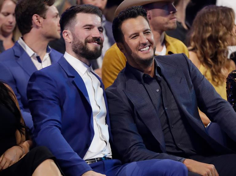 Sam Hunt, left, and Luke Bryan appear in the audience at the CMT Music Awards (AP Photo/Mark Humphrey)