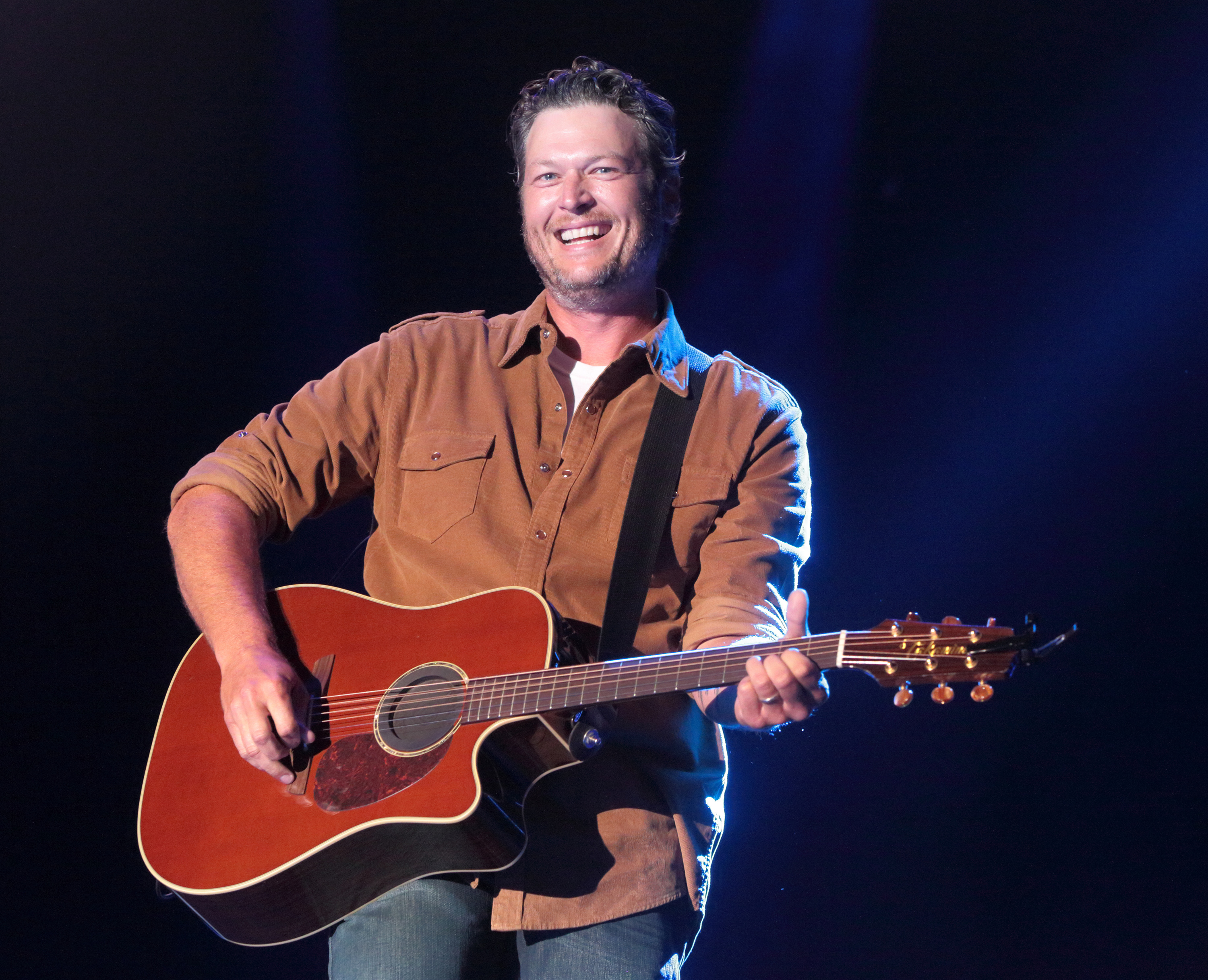 FILE - In this June 26, 2015 file photo, singer-songwriter Blake Shelton performs on Day 1 of the 2015 Big Barrel Country Music Festival at The Woodlands in Dover, Del. Shelton sued In Touch Weekly and its parent company Bauer Publishing Co. on Monday, Oct. 19, 2015, for defamation over a September cover story claiming the country music star was drinking heavily, it contributed to his divorce from Miranda Lambert and he was headed to rehab.  (Photo by Owen Sweeney/Invision/AP, File)