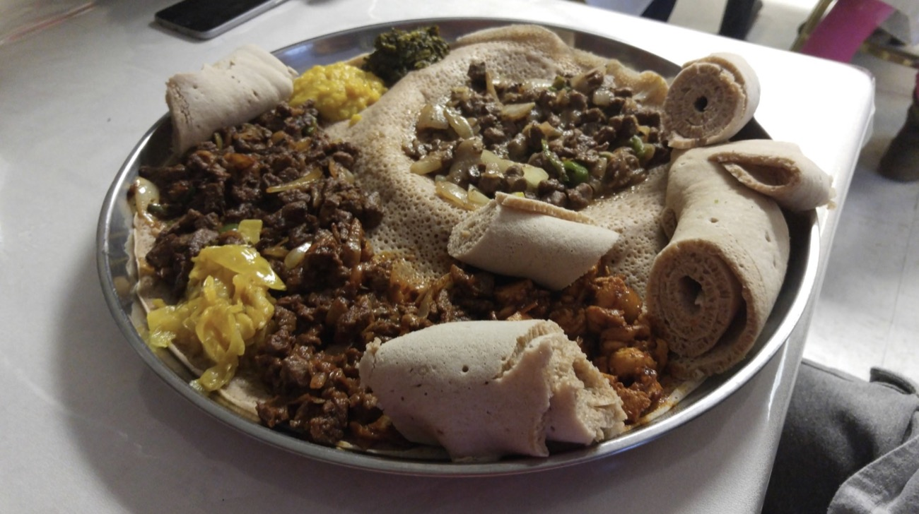 Banatu: Finely chopped beef seasoned with herbed butter and Mitmita on top of hot spicy beef stew tossed with injera / Image courtesy of Yelp user Alyssa H. // Published: 7.17.18