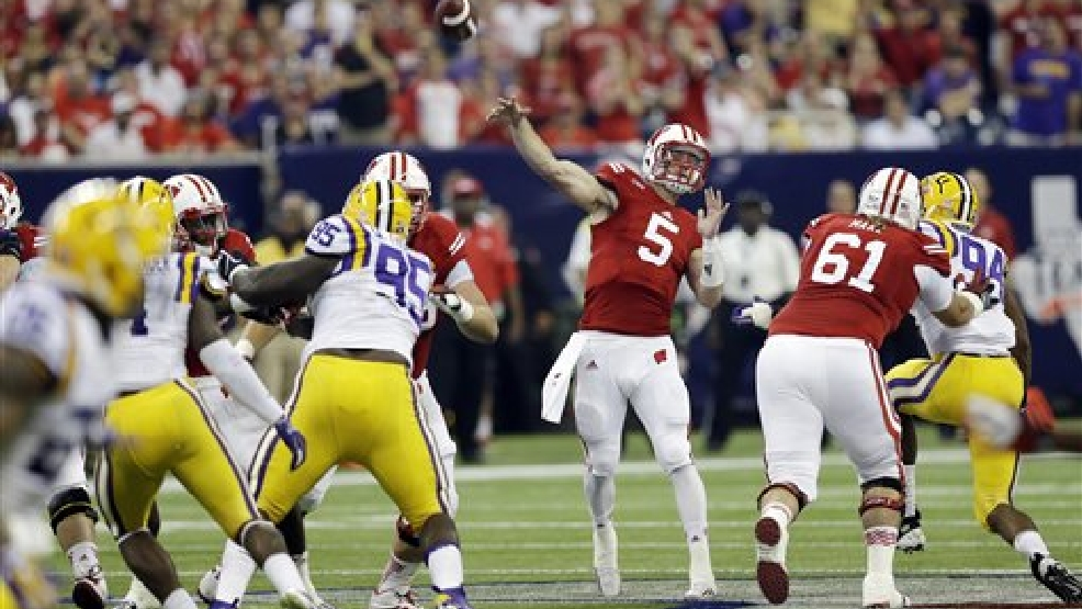 Wisconsin quarterback Tanner McEvoy (5) throws during the first half of an NCAA college football game against LSU Saturday, Aug. 30, 2014, in Houston. (AP Photo/David J. Phillip)