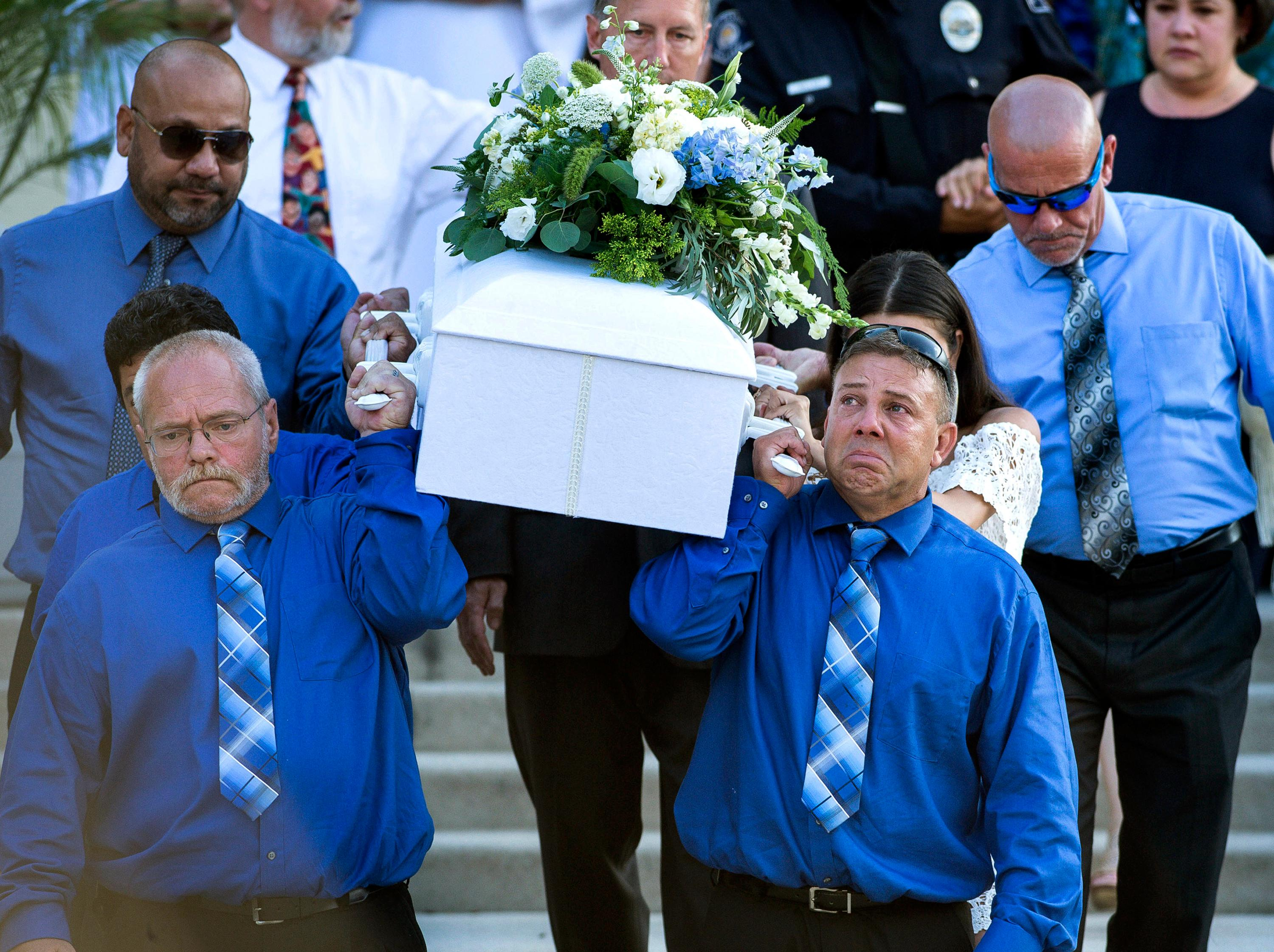 FILE - In this July 18, 2017, file photo, pallbearers carry the casket of Aramazd Andressian Jr. at his funeral at Holy Family Roman Catholic Church in South Pasadena, Calif.  (Sarah Reingewirtz /Los Angeles Daily News via AP, File)