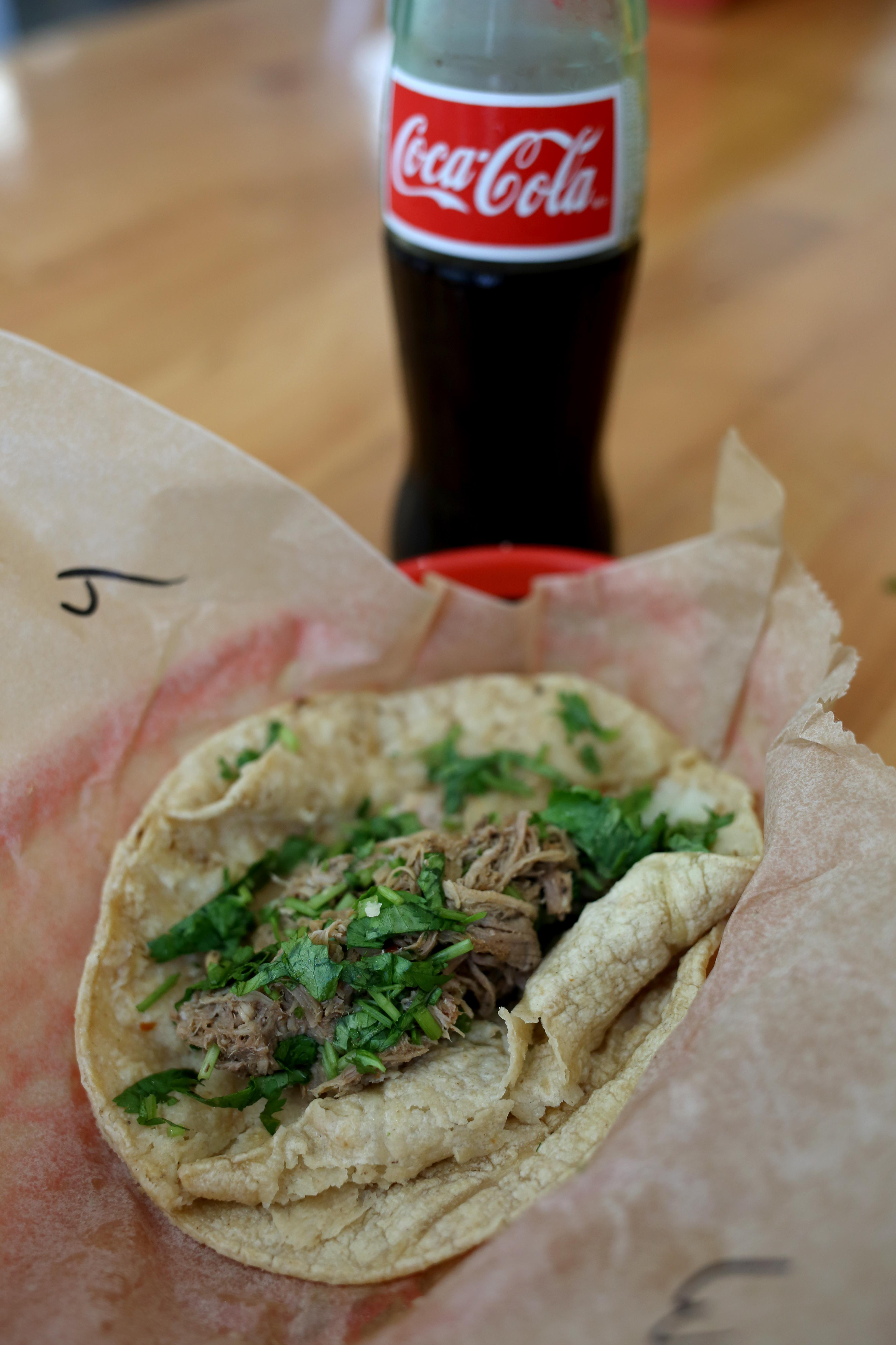 I have to give District Taco props for carrying Mexican Coke, but their carnitas were so wet and moist that even two tortillas couldn't hold up. (Amanda Andrade-Rhoades/DC Refined)