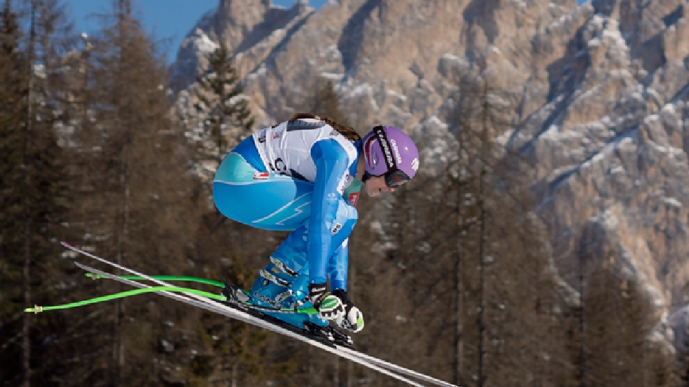 FILE - In this Saturday, Jan. 25, 2014 file photo, Slovenia's Tina Maze speeds down the course during an alpine ski, women's World Cup downhill, in Cortina D'Ampezzo, Italy. (AP Photo/Domenico Stinellis, File)
