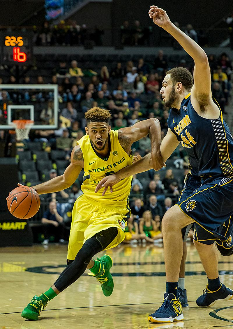Oregon's Tyler Dorsey (#5) looks to get by Cal's Cole Welle (#44) on his way to the basket. Led by a dominating performance by Chris Boucher, the Ducks downed the Bears 68-65 on Wednesday night at Matthew Knight Arena. Eric Cech, Oregon News Lab