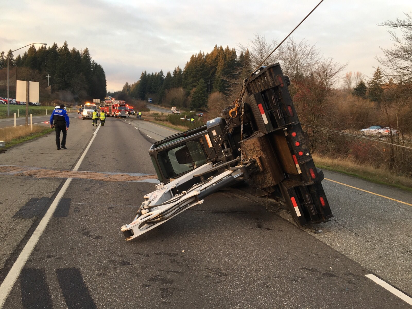 The State Patrol is investigating after a stolen truck hauling a trailer with an excavator on it overturned on eastbound State Route 16 near Port Orchard Monday afternoon. (Photo: South King Fire & Rescue)