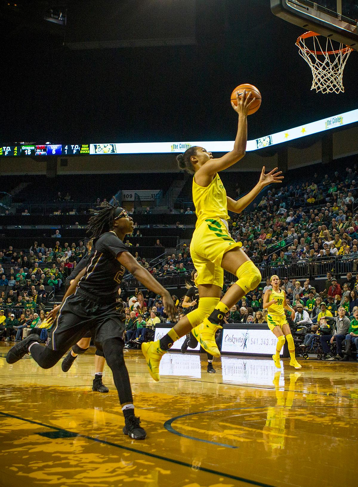 Oregon Ducks Satou Sabally (#0) makes a layup during the first half of the game against the Washington Huskies on Sunday evening. The Oregon Ducks defeated the Washington Huskies 94-83 on Sunday at Matthew Knight Arena. The victory was Head Coach Kelly Graves' 500th career win. Sabrina Ionescu also set the new NCAA all time record of 8 triple doubles in just 48 games. The previous record was 7 triple doubles in 124 games, held by Susie McConnell at Penn State. The Ducks will next face off against USC on Friday January 5th in Los Angeles. Photo by Rhianna Gelhart, Oregon News Lab