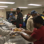 Giving a helping hand: Volunteers host dinner for the homeless