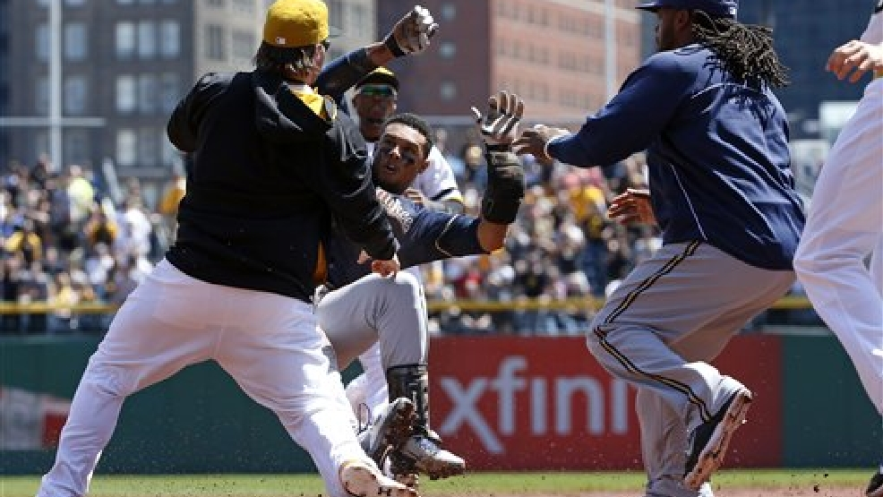 Pittsburgh Pirates' Travis Snider, left, takes down Milwaukee Brewers' Carlos Gomez (27) as Brewers' Rickie Weeks, right, joins a skirmish between the two teams during the third inning of a baseball game in Pittsburgh Sunday, April 20, 2014. Gomez was ejected from the game. (AP Photo/Gene J. Puskar)