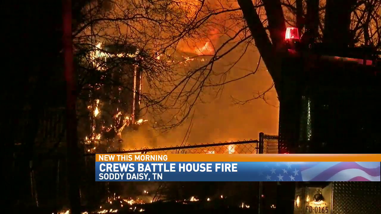 Firefighters battle a house fire in Soddy Daisy early Sunday. (Image: WTVC)
