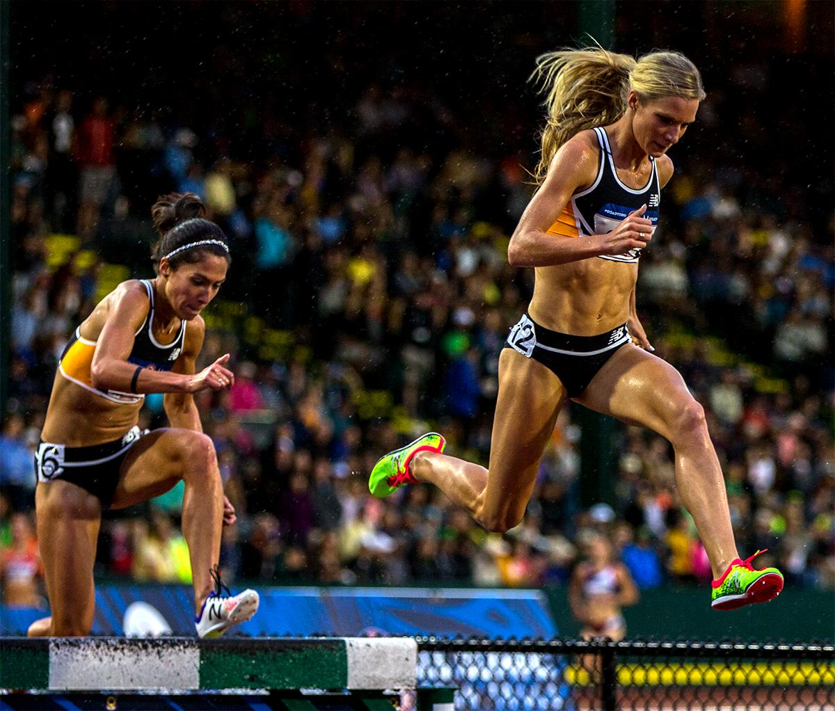 New Balance's Emma Coburn leaps into the water pit one her way to a victory in the 3,000 meter steeplechase. Coburn won with a time of 9:17.48. Photo by August Frank, Oregon News Lab