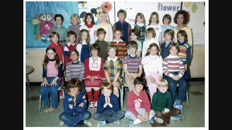 Stacey Mooney (top row, center) in a class photo at Lyseth Elementary School. She is now a special education ed tech at Lyseth (Courtesy: Stacey Mooney).