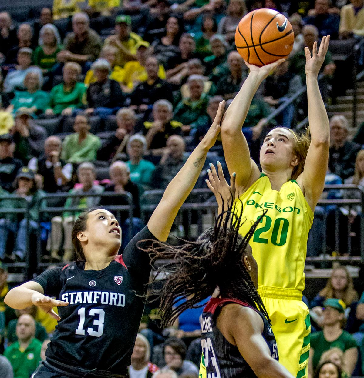 The Duck's Sabrina Ionescu (#20) goes for a jump shot. The Stanford Cardinal defeated the Oregon Ducks 78-65 on Sunday afternoon at Matthew Knight Arena. Stanford is now 10-2 in conference play and with this loss the Ducks drop to 10-2. Leading the Stanford Cardinal was Brittany McPhee with 33 points, Alanna Smith with 14 points, and Kiana Williams with 14 points. For the Ducks Sabrina Ionescu led with 22 points, Ruthy Hebard added 16 points, and Satou Sabally put in 14 points. Photo by August Frank, Oregon News Lab
