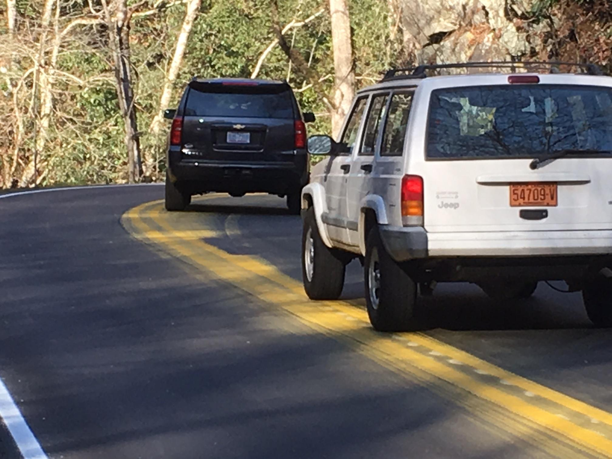 Drivers say a crew painted the yellow center line along a section of Wayah Road Saturday night in the Nantahala community. But they say the road was too wet and temperatures too cold for the paint to stick. The result was many vehicles getting splashed in yellow paint. (Photo credit: WLOS Staff)