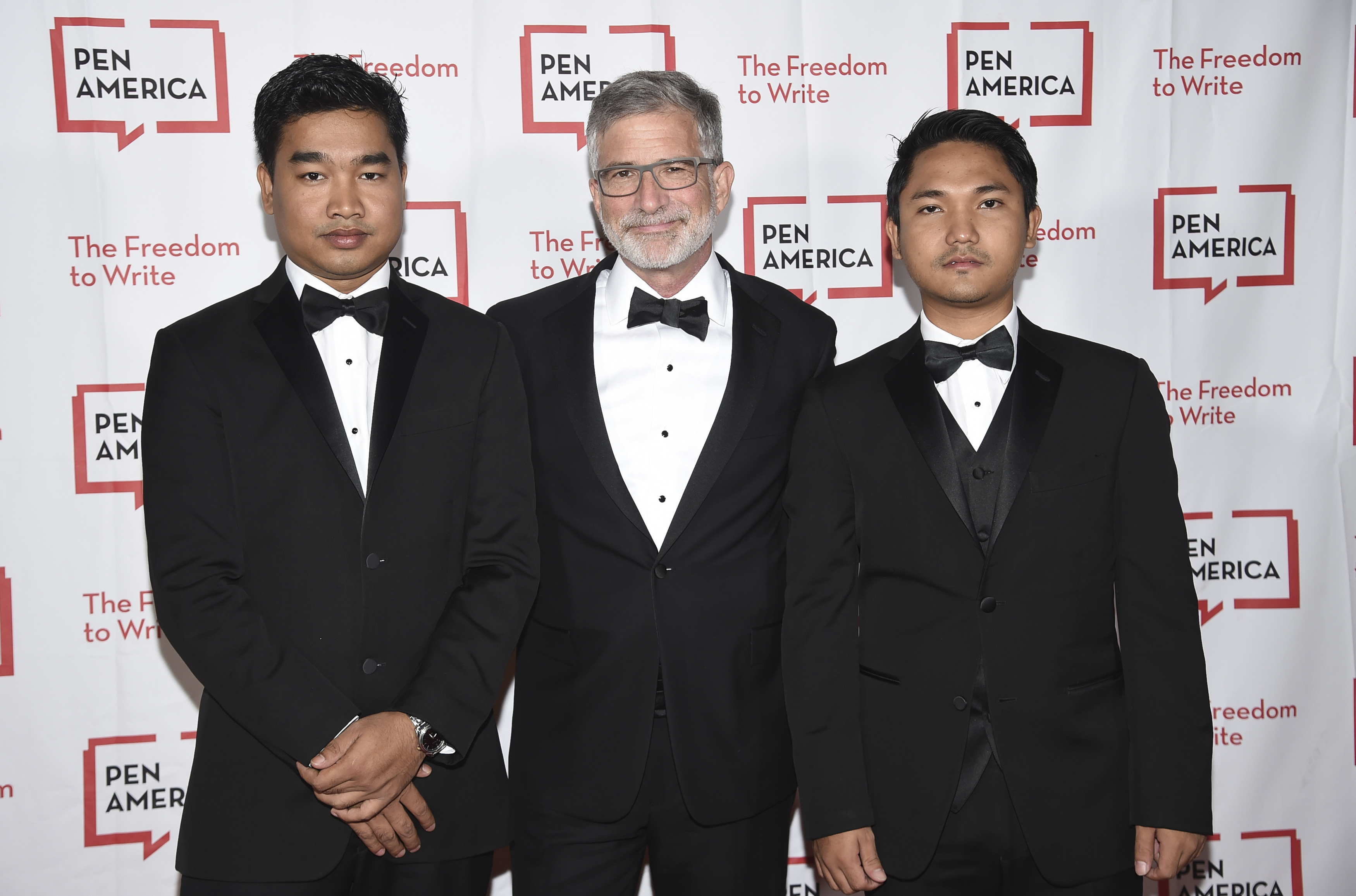 Publisher, CEO and president of Reading Eagle Company Peter Barbey, center, poses with detained Myanmar journalist Wa Lone's brother Thura Aung, left, and brother-in-law Win Khant Kyaw at the 2018 PEN Literary Gala at the American Museum of Natural History on Tuesday, May 22, 2018, in New York. (Photo by Evan Agostini/Invision/AP)