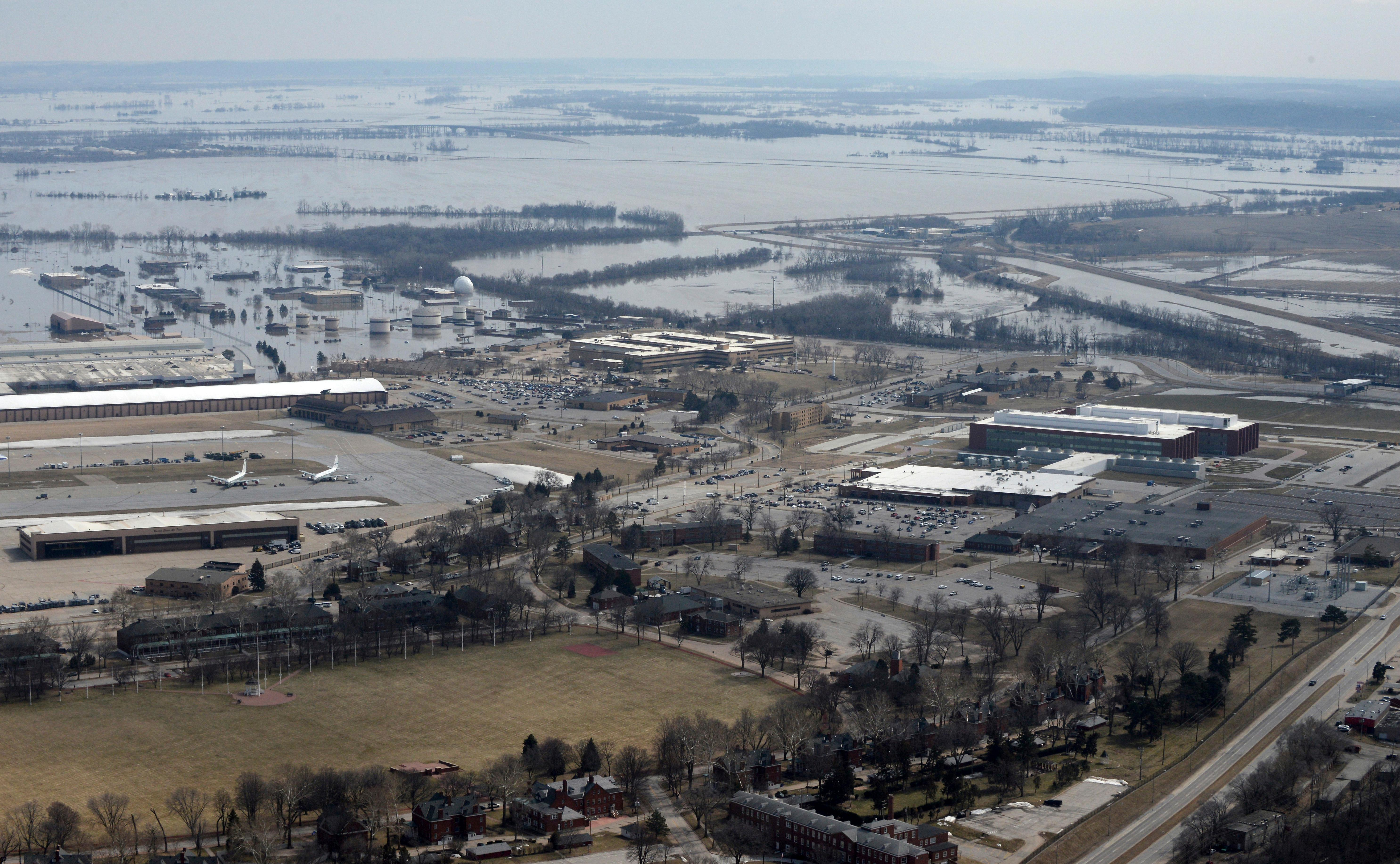 This March 17, 2019 photo released by the U.S. Air Force shows an aerial view of Offutt Air Force Base and the surrounding areas affected by flood waters in Neb.{ } (Tech. Sgt. Rachelle Blake/The U.S. Air Force via AP)