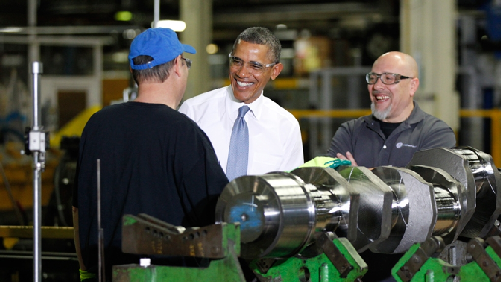 President Barack Obama speaks with employees Calvin Anderson, left, and Theodore (Ted) Korber at GE Energy in Waukesha, Wis. Thursday, Jan. 30, 2014. The visit is part of a four-state tour the president is making following his State of the Union speech on Tuesday. (AP Photo/Milwaukee Journal-Sentinel, Mike De Sisti, Pool)