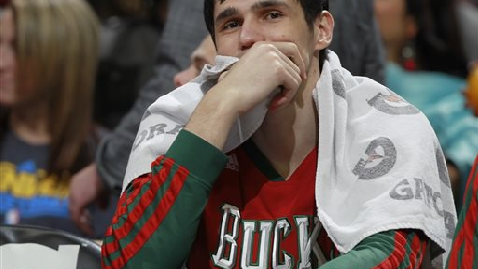 Milwaukee Bucks forward Ersan Ilyasova, of Turkey, looks on from bench late in the fourth quarter of the Denver Nuggets' 110-100 victory over the Bucks in an NBA basketball game in Denver on Wednesday, Feb. 5, 2014. (AP Photo/David Zalubowski)