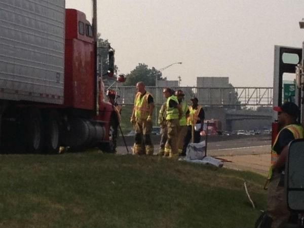 Emergency crews work to clean-up a chemical spill on I-35 as traffic backs up.