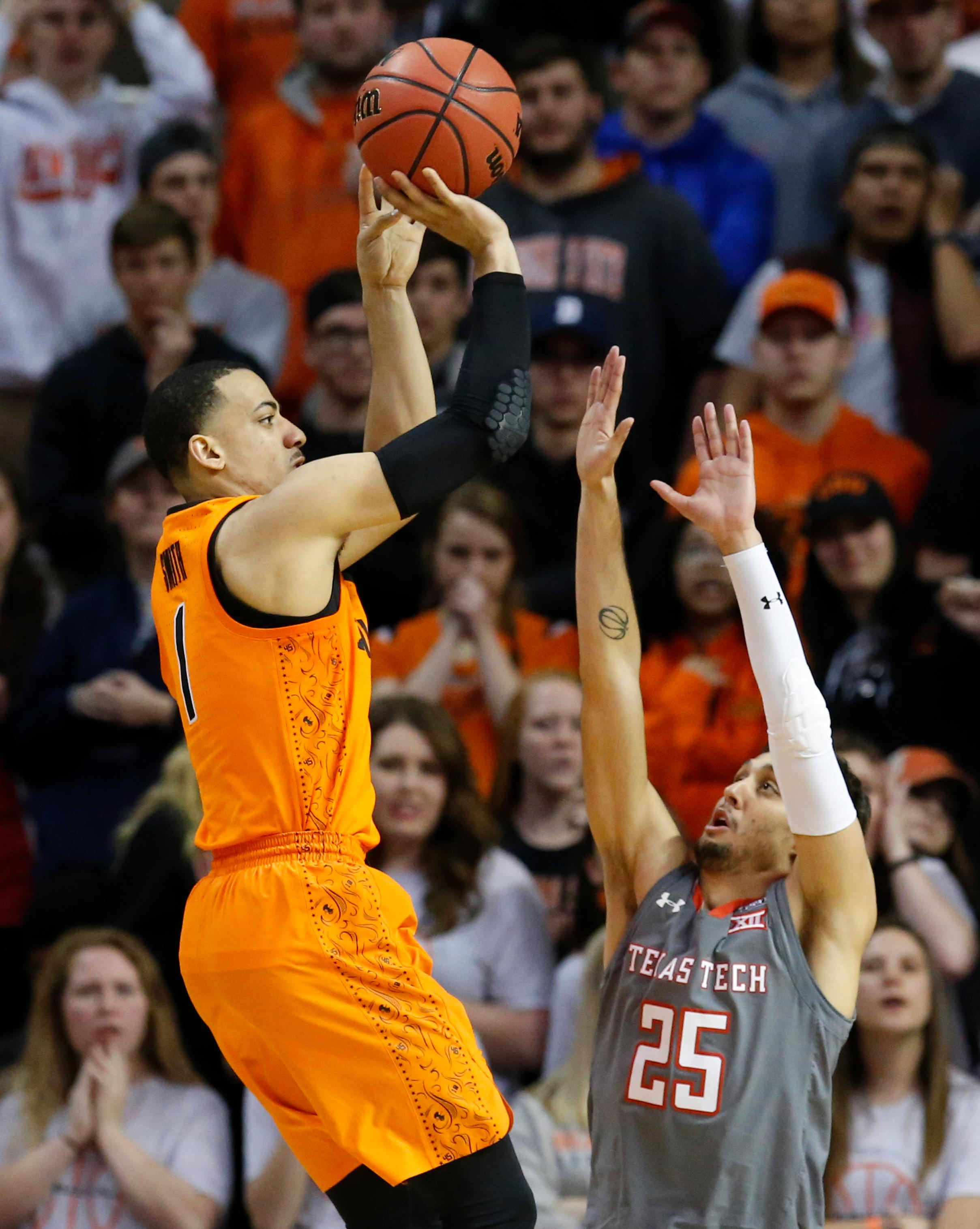 Oklahoma State guard Kendall Smith, left, shoots over Texas Tech guard Davide Moretti (25) during the second half of an NCAA college basketball game in Stillwater, Okla., Wednesday, Feb. 21, 2018. (AP Photo/Sue Ogrocki)