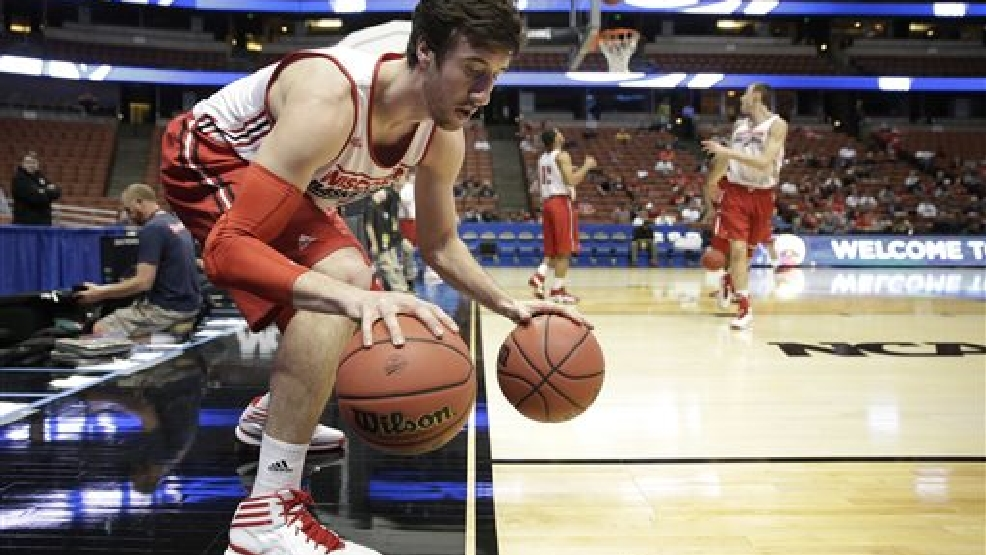 Wisconsin's Frank Kaminsky dribbles two balls during practice at the NCAA men's college basketball tournament, Wednesday, March 26, 2014, in Anaheim, Calif. Wisconsin plays Baylor in a regional semifinal on Thursday. (AP Photo/Jae C. Hong)