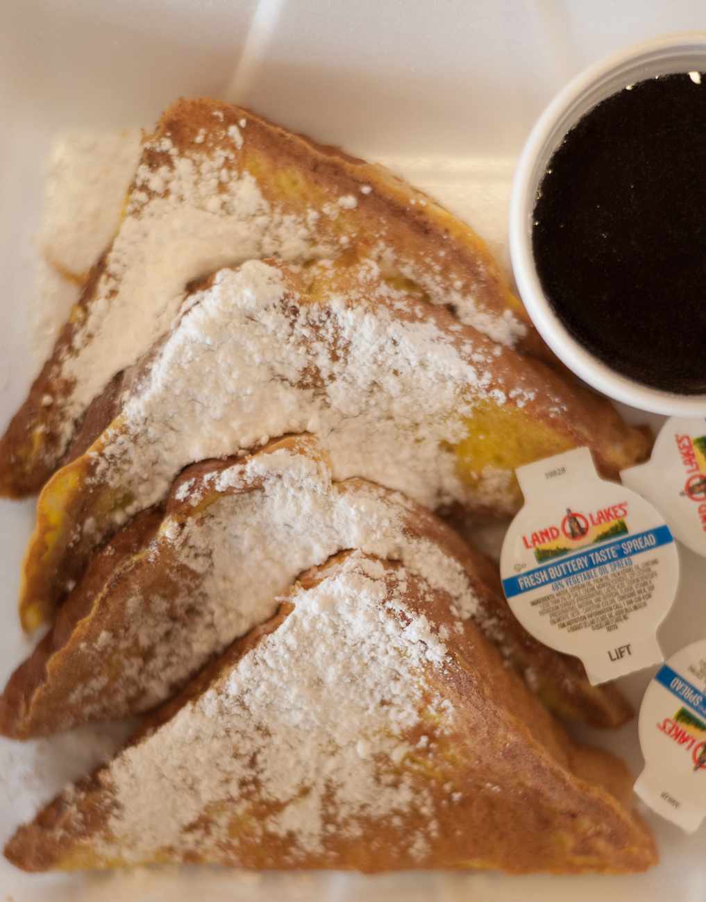 French Toast with butter, syrup, and powdered sugar{ }/ Image: Kellie Coleman // Published: 4.8.20
