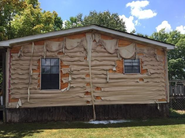 Siding melts on a nearby home from heat caused by a garage fire. (Wilson County EMA)
