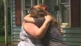 2 women lean on each other after the killing of one's fiancé