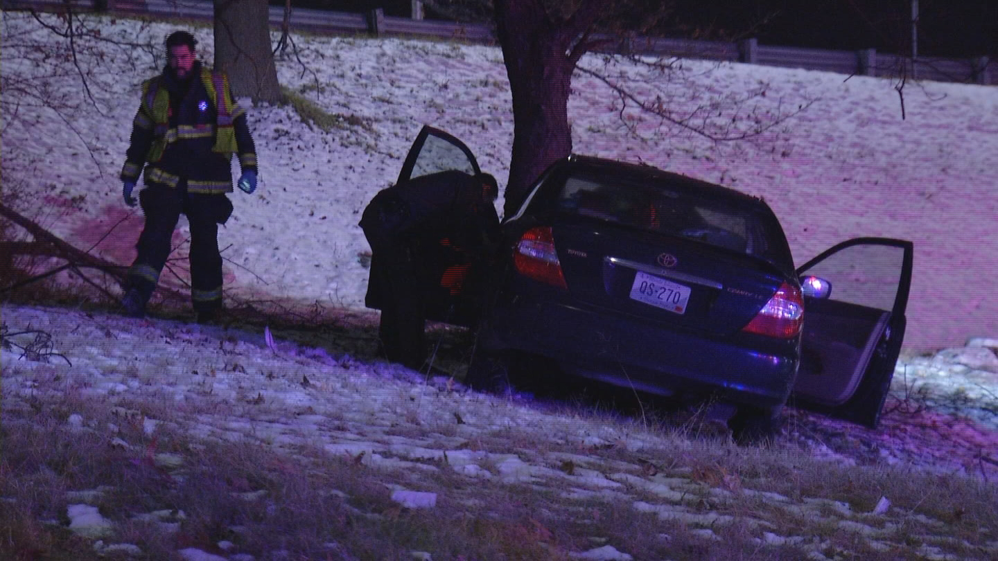 A car crashed into a tree off Interstate 195 in East Providence, Tuesday, Dec. 12, 2017. (WJAR)