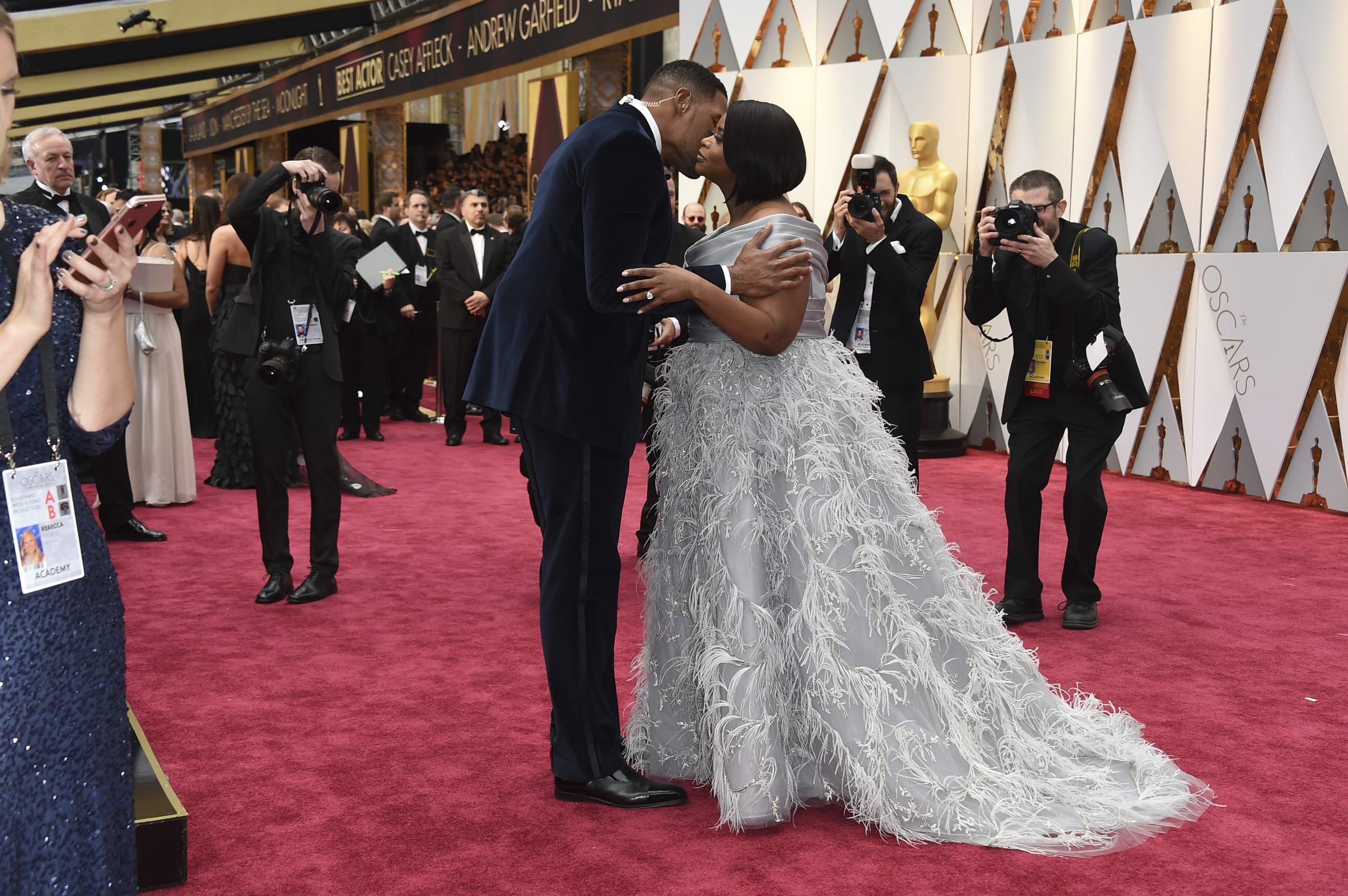 Michael Strahan, left, and Octavia Spencer embrace at the Oscars on Sunday, Feb. 26, 2017, at the Dolby Theatre in Los Angeles. THE ASSOCIATED PRESS