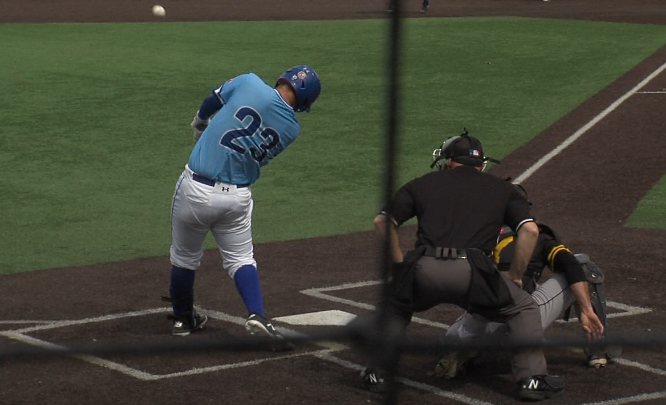 UNK senior Dallas Schramm (23) hits a home run in an April 11, 2018 game at Memorial Field in Kearney, Neb. against Fort Hays State (KHGI)
