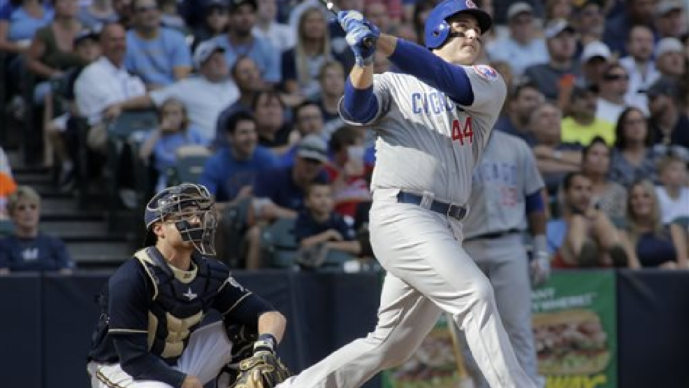 Chicago Cubs first baseman Anthony Rizzo, right, hits a two-run home run against the Milwaukee Brewers during the sixth inning of a baseball game Saturday, May 31, 2014, in Milwaukee. (AP Photo/Darren Hauck)
