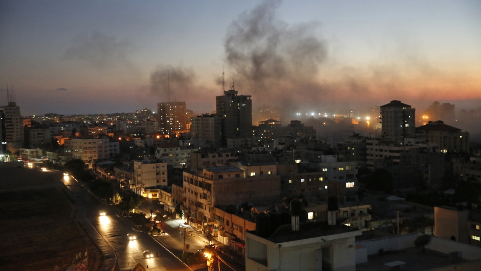 Smoke from fires caused by Israeli strikes rises over Gaza City, Sunday, Aug. 10, 2014. (AP Photo/Lefteris Pitarakis)