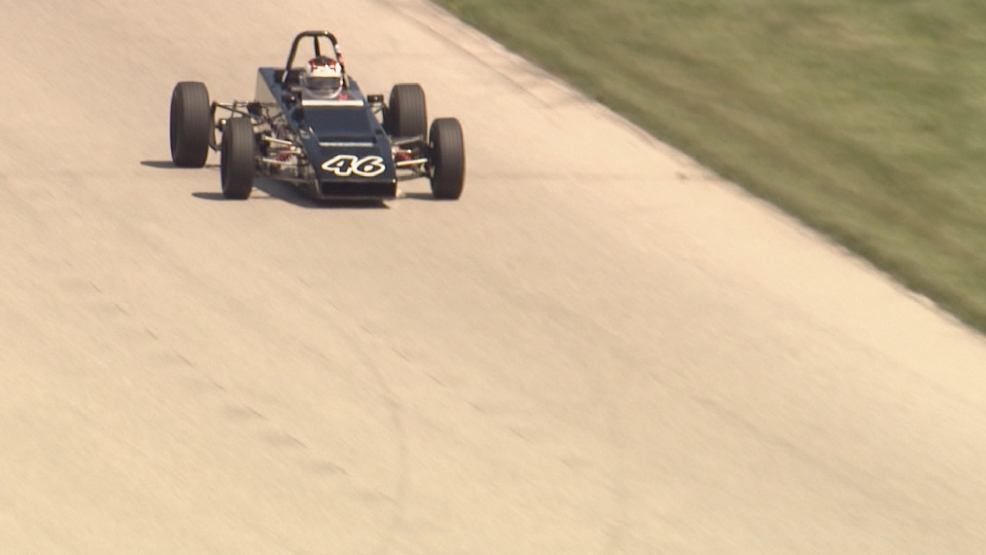 A vintage car takes a spin during a practice session at Road America race course in Elkhart Lake, Wisconsin.
