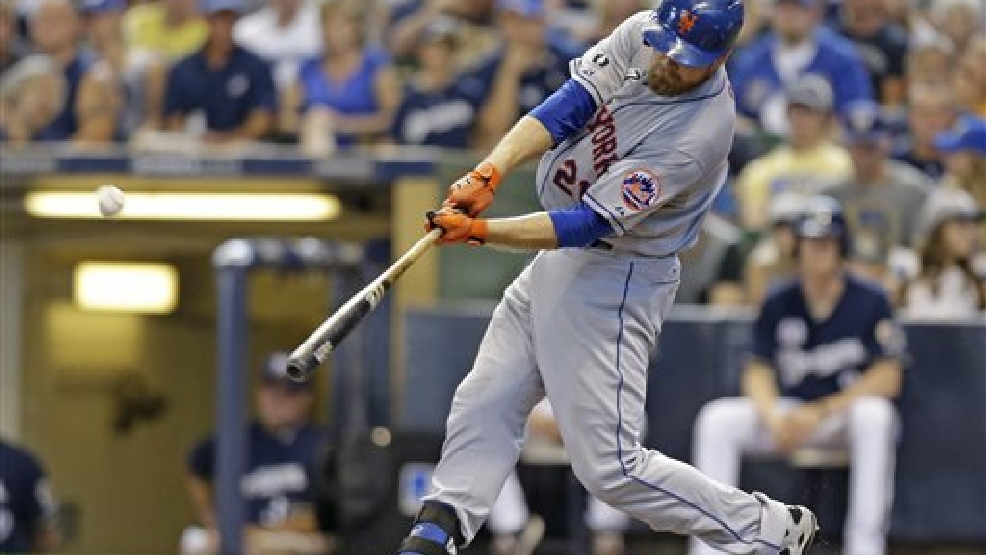 New York Mets' Lucas Duda hits a two-run home run against the Milwaukee Brewers during the sixth inning of a baseball game Sunday, July 27, 2014, in Milwaukee. (AP Photo/Jeffrey Phelps)