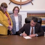 Gov. Sandoval signs bill that expands benefits to state dependents