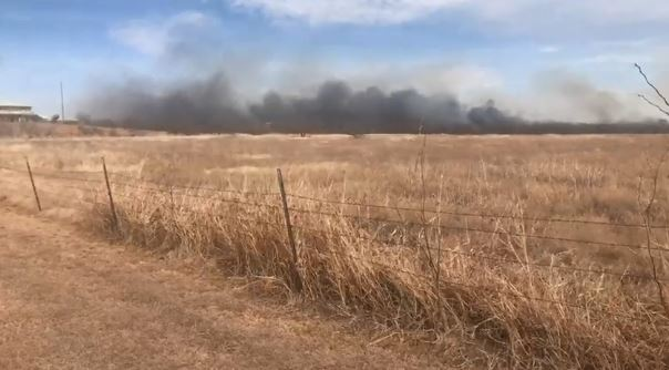 Multiple agencies responded to a two- to three-acre wildfire in Jones County -- just east of the Abilene landfill. The fire burned numerous old vehicles on Private Road 343 and threatened dozens of homes. Photos by Nick Bradshaw/KTXS News<p></p>