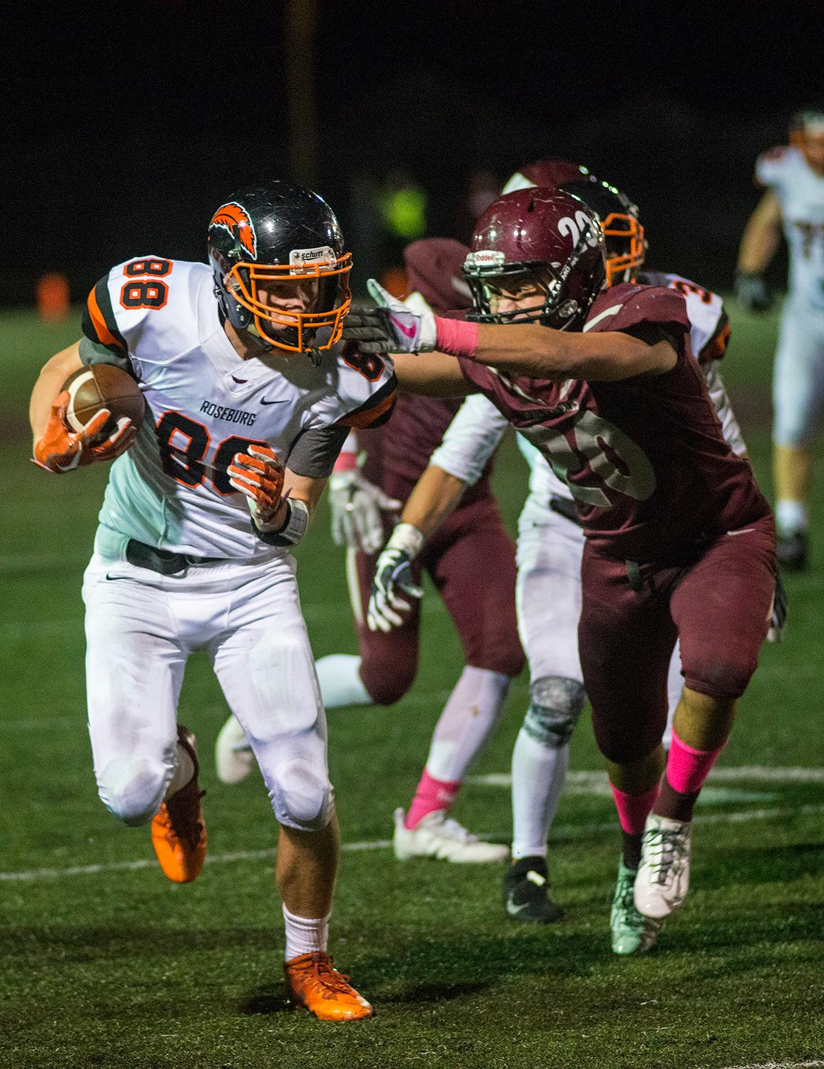 Roseburg Indians Garrett Russell (#88) attempts to keep the ball away from Willamette Wolverines Tanner Webb (#20). Roseburg Indians defeated Willamette Wolverines 21-20 at Wolverine Stadium on Friday night in Eugene. Photo by Rhianna Gelhart, Oregon News Lab