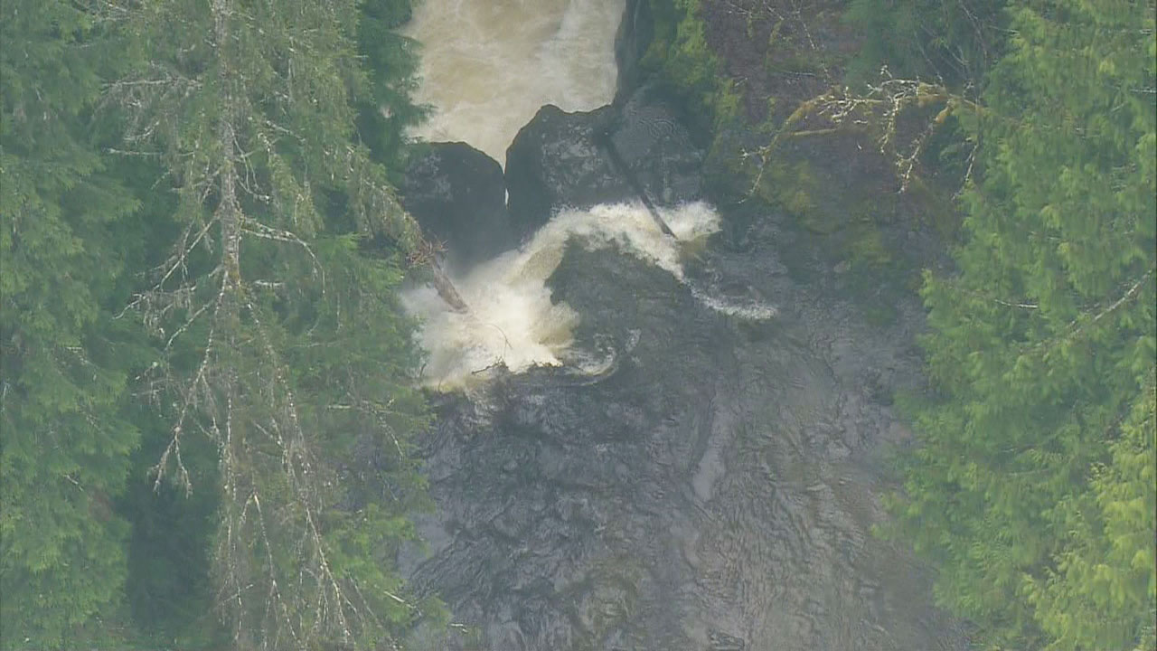 Crews search for a woman who tumbled over falls near a Snohomish County lake on April 13, 2018. (KOMO News){ }