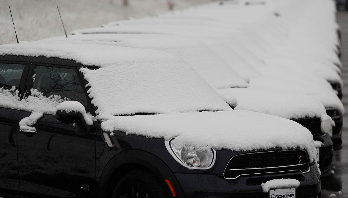A line of Mini Coopers sits dusted with snow as a weak, autumnal storm sweeps over the intermountain West, Thursday, Nov. 17, 2016, in Highlands Ranch, Colo. The fast-moving storm is predicted to drop up to a foot of snow in the upper reaches of Minnesota. (AP Photo/David Zalubowski)